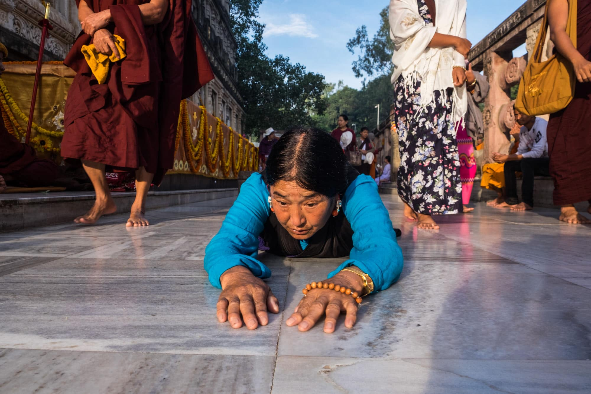 A tibetan lady undertakes a parikrama of the Mahabodhi temple